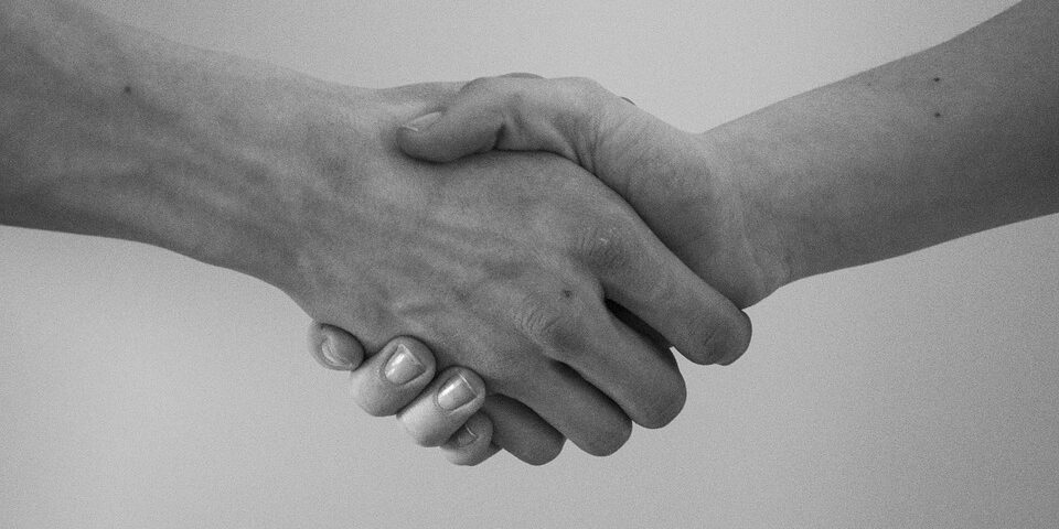 Firm handshake between a man and woman